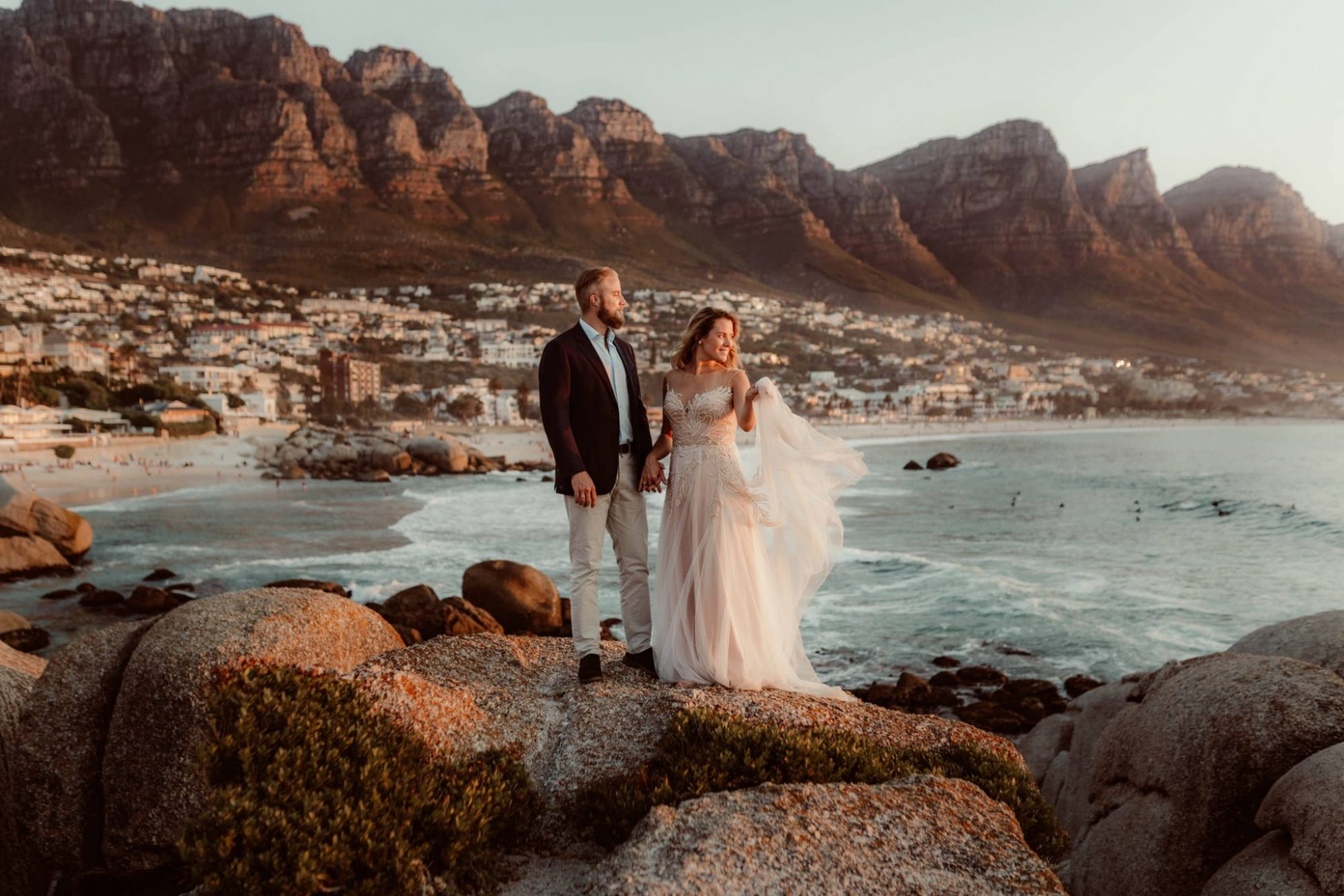 camps-bay-post-wedding-couple-photoshoot-cr8tiveduo-photographer-sunset-walk-ocean-mountains-views-dress-holding