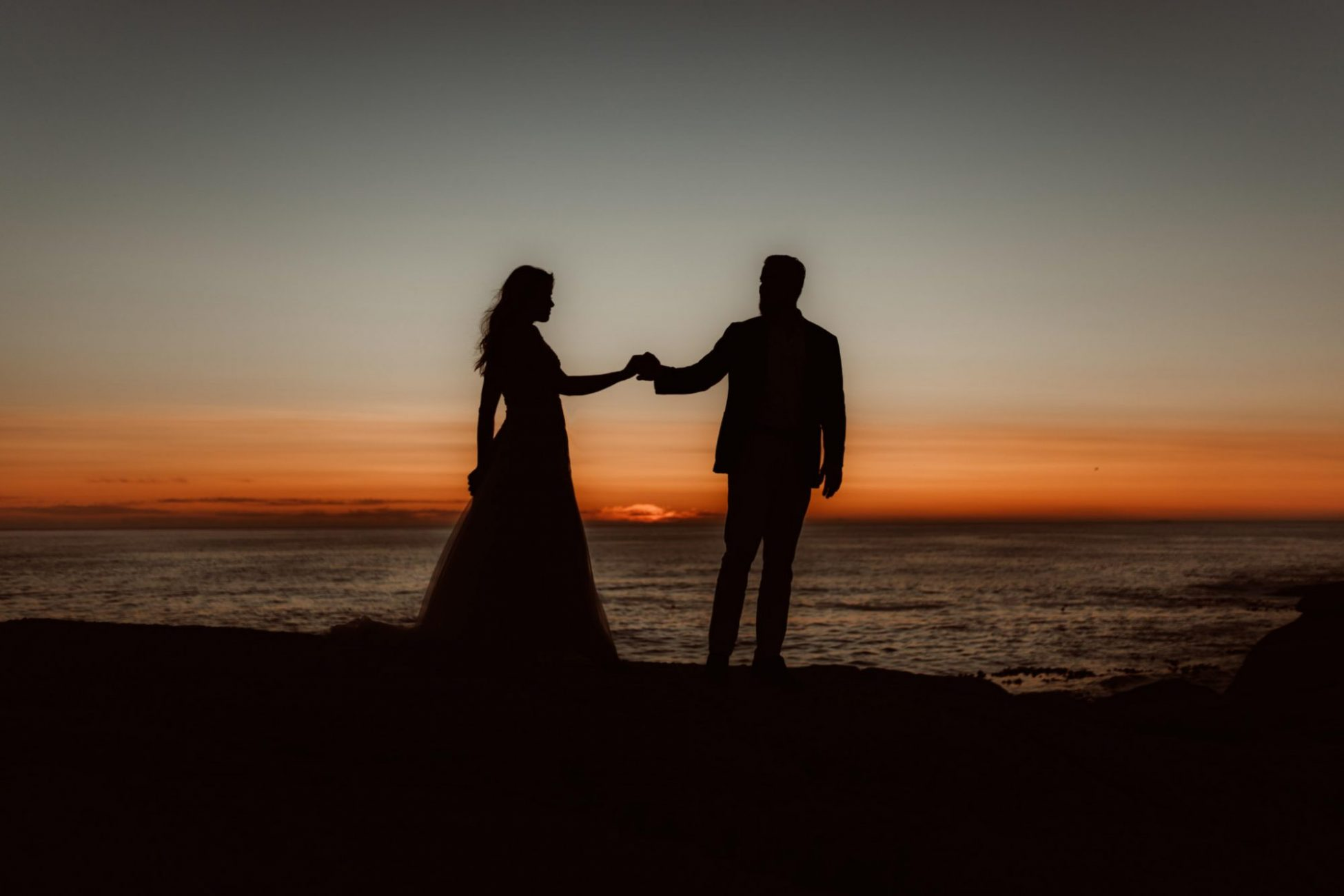 camps-bay-post-wedding-couple-photoshoot-cr8tiveduo-photographer-sunset-ocean-views-orange-sky-silhouettes